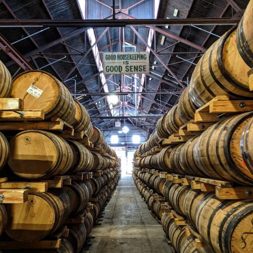 rows of bourbon barrels at new riff distillery's whiskey campus in newport kentucky