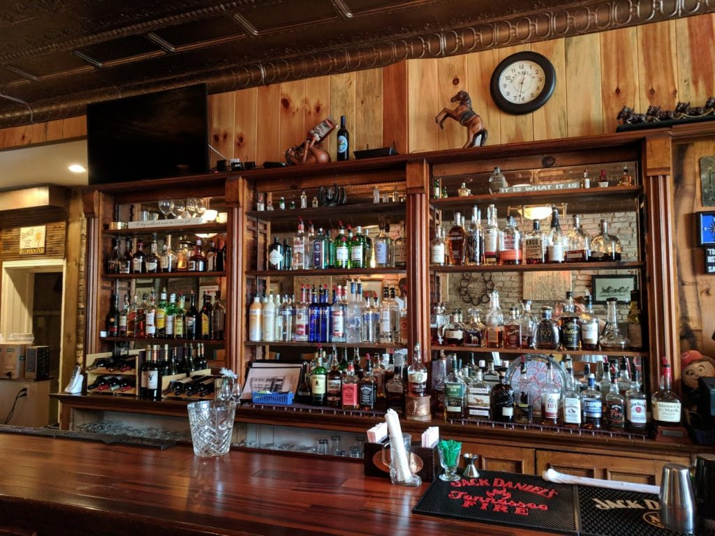 The wood bar and wood wall and shelvers at Chandler's on Market