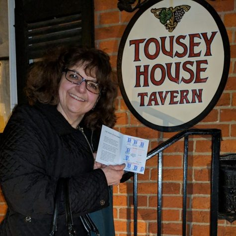 anette bisbee completed her b-line line guide and is posing in front of b-line stop tousey house tavern