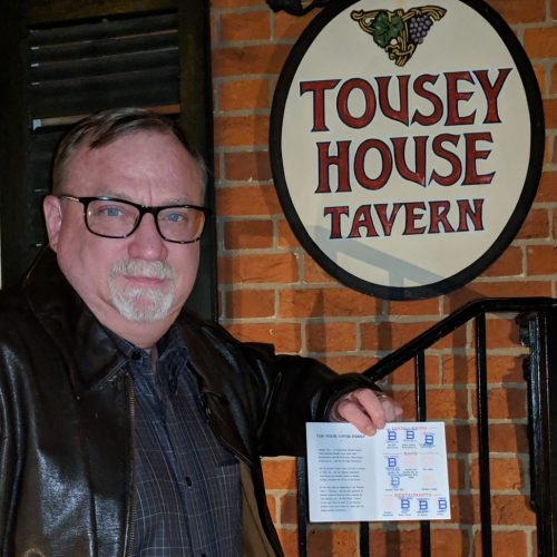 randall bisbee completed his b-line line guide and is posing in front of tousey house tavern