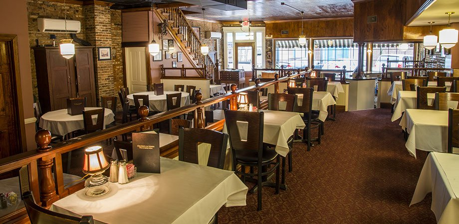 dining room at chandler's restaurant in maysville ky features white table cloths and elegant dining