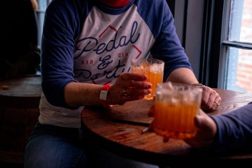 Bourbon cocktail toast at Bourbon Haus 1841 on The B-Line by someone wearing a Pedal Wagon Covington t-shirt