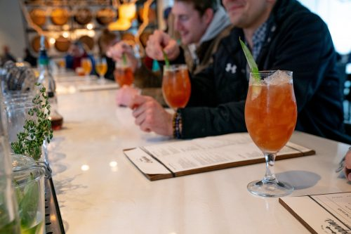 A row of bourbon cocktails on the bar at Coppin's at Hotel Covington on The B-Line in NKY