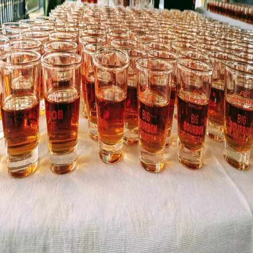 big bourbon toast glasses filled with New Riff bourbon