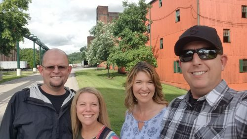 group of people smiling for selfie at buffalo trace distillery in frankfort kentucky