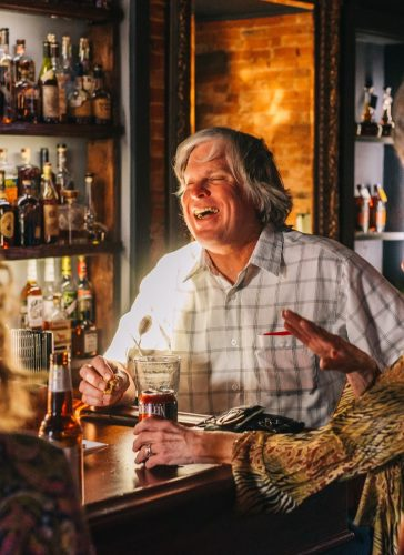 old man drinking bourbon
