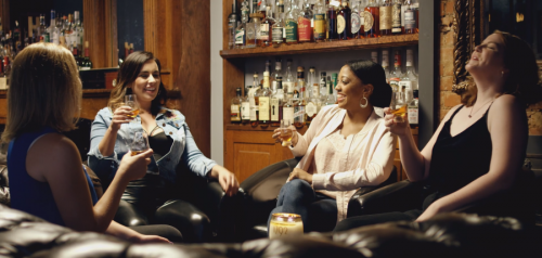 women drinking bourbon