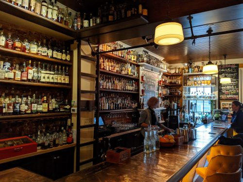 More than 600 bourbons lining the walls behind the bar at OKBB in Covington, KY