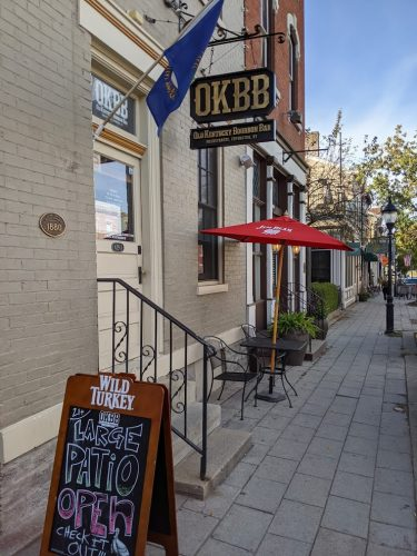 The OKBB sign hanging next to the front door in Mainstrasse Village