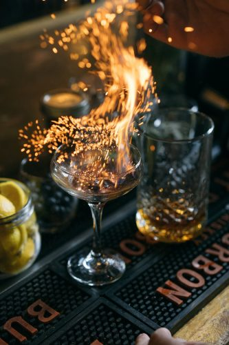 Bourbon Cocktail at Wiseguy Lounge in Mainstrasse with lots of fire and sparks coming out of the glass