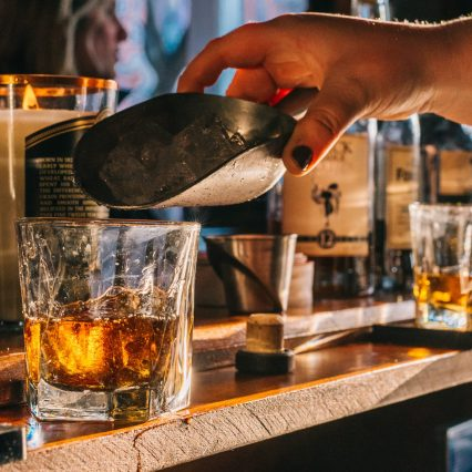 close up of bar tender hands making bourbon drinks at bourbon haus 1841 in covington ky mainstrasse village