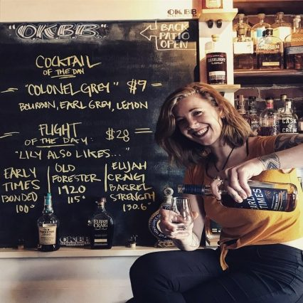 Lily Dean pouring bourbon at Old Kentucky Bourbon Bar