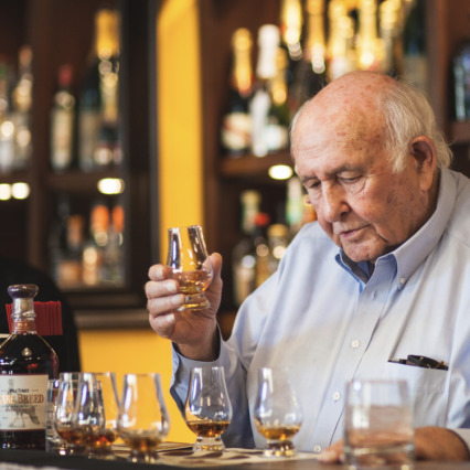 Photo of Jimmy Russell tasting bourbon at Prohibition Bourbon Bar