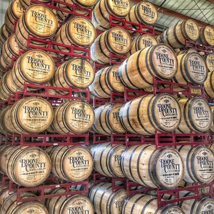 Aging bourbon barrels stacked six rows high at Boone County Distilling Company in Northern Kentucky