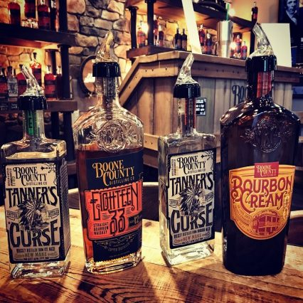 Four bottles of bourbon, bourbon cream, and white dog from Boone County Distilling.