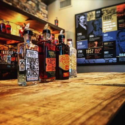 Picture of bottles of Tanner's Curse, Eighteen 66, and Bourbon Cream featured at Boone County Distilling Company in Northern Kentucky
