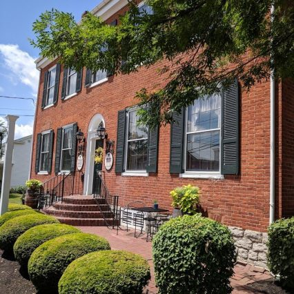 exterior of tousey house tavern, a restaurant inside of a historic building in burlington ky